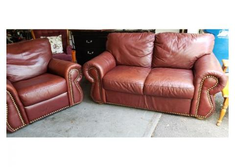 Reclining leather chair and matching loveseat